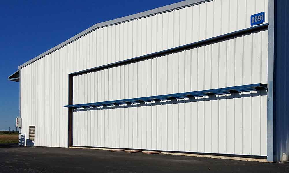 Tilt-Over Hangar Door